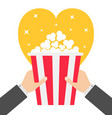 two human businessman hands holding popcorn box vector image vector image