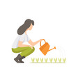 girl watering seedlings with a watering can woman vector image vector image