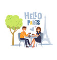 couple siting at parisian cafe vector image vector image