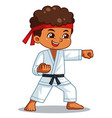 karate boy performing fist technique vector image vector image