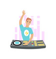 young dj with hand up mixing music on turntables vector image
