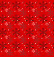 christmas seamless pattern of snowflakes on red vector image vector image