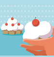 hand with cupcakes vector image