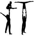 gymnasts acrobats black silhouette on black vector image
