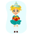 Little girl in party hat holding birthday gift vector image