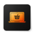 orange glowing shopping basket on screen laptop vector image vector image