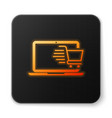 orange glowing shopping cart on screen laptop icon vector image vector image