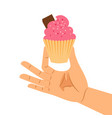 hand holding pastry pink cupcake vector image vector image