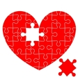 Jigsaw puzzle in the red heart vector image vector image