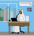 arabic businessman working on laptop in office vector image vector image