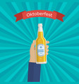 hand holding bottle beer vector image vector image