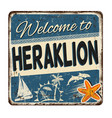welcome to heraklion vintage rusty metal sign vector image vector image