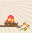 family of birds in nest on blooming branch vector image