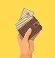 hand and wallet full money vector image vector image
