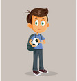 boy holding a soccer ball going to school vector image