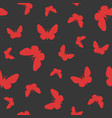 red butterfly on black background vector image vector image