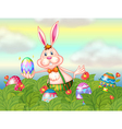 A rabbit with easter eggs in the garden vector image vector image
