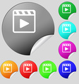 Play video icon sign Set of eight multi-colored vector image