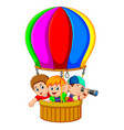 kids in a balloon vector image