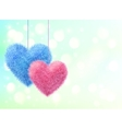 blue and pink fluffy hearts pair on bokeh vector image vector image