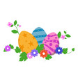 easter eggs in green grass with flowers isolated vector image vector image