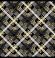 golden snowflakes seamless on dark tartan fabric vector image