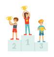 happy children standing on the winner podium with vector image vector image