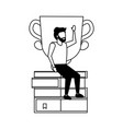 man sitting books pile with trophy vector image