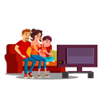 family spending time together on the sofa in front vector image