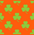 clover pattern on an orange background vector image vector image