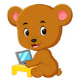 cute bear using laptop computer vector image