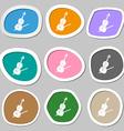 Violin symbols Multicolored paper stickers vector image