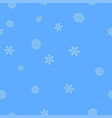 blue snowflakes on a light blue background vector image vector image