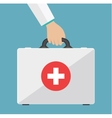 first aid kit in the doctors hands vector image vector image