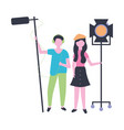 man and woman with microphone and light production vector image