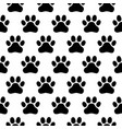 seamless pattern of print of dogs paws on a white vector image
