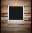 Photo frame stick on vintage wooden texture vector image vector image