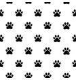black and white seamless pattern with paw prints vector image