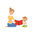 mother reading a book to her little son vector image vector image