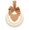 Badge with heart golden ribbon and a bow vector image
