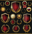gold and red shields labels and laurels vector image