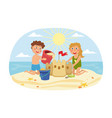 young brother an sister building a sand castle vector image