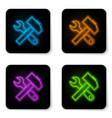 glowing neon crossed hammer and wrench icon vector image vector image