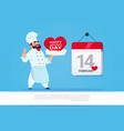 male cook holding cake for happy valentines day vector image vector image