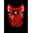 Red Christmas ball with a bow isolated on black vector image