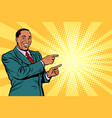 african businessman pointing finger at the side vector image vector image