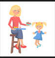mother feeds her little daughter with strawberries vector image