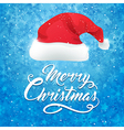 Blue Christmas background with hat of Santa Claus vector image