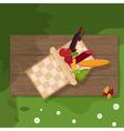 picnic basket on wooden background vector image vector image