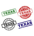 grunge textured texas seal stamps vector image